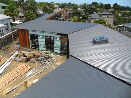 Prospect trc,Mt Eden. Colour steel roof installed, vertical cedar cladding being installed