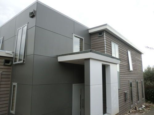 Ngaiwi st, Orakei. Leaky home renovation and reclad with negative detailed titan board and cedar weatherboards.Photo shows almost finished