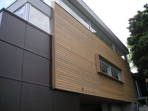 Bay rd, St Heliers bay. New house clad with Maranti plywood with horizontal batten and rusticated cedar weatherboard