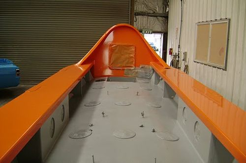 Looking down the deck of the Tasman boat. It is painted grey to lower the glare on bright days at sea.