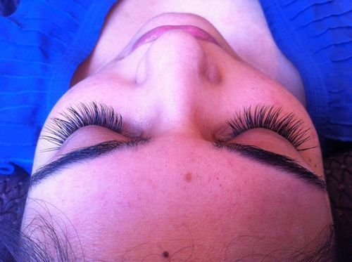Customized semi-permanent lashes, filled in with additional lashes to create a luxurious look