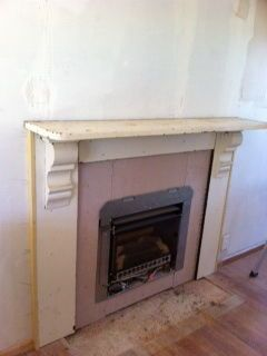 Installing a new gas fireplace with its surround