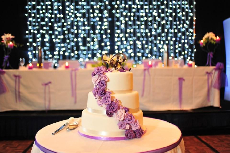 Violet garden! Cascading handmade rose wedding cake