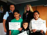 Louise Grevel and Community Constable Dorothy Iosia presented Pale, Jason and Rosaline (left to right) with their prizes. Harmony was absent.